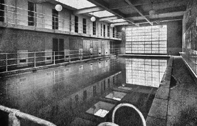 A historical image of the Popular Baths that occupied the premises before the gymnasium.